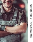handsome mechanic in uniform is ... | Shutterstock . vector #618010085