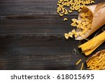dried mixed pasta on the dark... | Shutterstock . vector #618015695