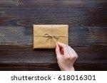 female hand unpacking gift box... | Shutterstock . vector #618016301
