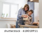 family time in kitchen. mother... | Shutterstock . vector #618018911