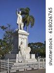 Small photo of CIENFUEGOS. CUBA. 13 APRIL 2014 : Statue of Jose Marti in Jose Marti park. Cienfuegos. Cuba