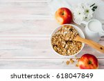 bowl with muesli and apples on... | Shutterstock . vector #618047849