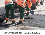 workers on asphalting paver... | Shutterstock . vector #618051239