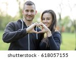 beautiful young couple in park | Shutterstock . vector #618057155