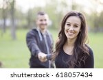 beautiful young couple in park | Shutterstock . vector #618057434