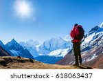 hiking in himalaya mountains | Shutterstock . vector #618063437