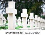 White Crosses On The Graves Of...