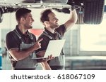 handsome mechanics in uniform... | Shutterstock . vector #618067109