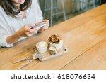 asian girl taking photo of... | Shutterstock . vector #618076634