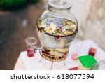 lemonade in a glass barrel.... | Shutterstock . vector #618077594