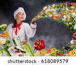 young woman chef blowing fresh... | Shutterstock . vector #618089579