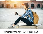 skateboarder girl listening to... | Shutterstock . vector #618101465