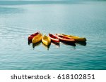 kayaks moored in the water.... | Shutterstock . vector #618102851