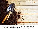 garden scoop and loose soil | Shutterstock . vector #618139655