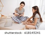 confident young mother using... | Shutterstock . vector #618145241