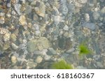 sea pebble beach with... | Shutterstock . vector #618160367