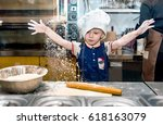 a child cook prepares pizza in... | Shutterstock . vector #618163079