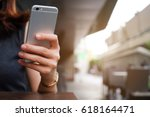 close up hand hold mobile cell... | Shutterstock . vector #618164471