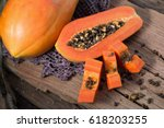 papaya on wooden background.... | Shutterstock . vector #618203255