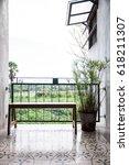 wooden bench at the corridor... | Shutterstock . vector #618211307