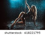 young sexy slim woman pole... | Shutterstock . vector #618221795