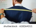 clothier measuring back width... | Shutterstock . vector #618264311