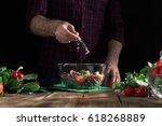 man preparing healthy salad of... | Shutterstock . vector #618268889
