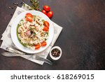 paste with tomatoes  seafood...   Shutterstock . vector #618269015