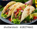 mexican tacos with beef in... | Shutterstock . vector #618274661