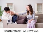 wife caring for sick husband at ... | Shutterstock . vector #618295961