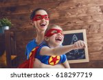 mother and her child playing... | Shutterstock . vector #618297719