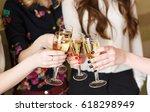hands holding the glasses of... | Shutterstock . vector #618298949
