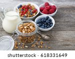 glass jar with granola  milk ... | Shutterstock . vector #618331649