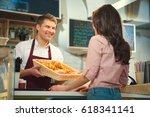 smiling worker in bakery | Shutterstock . vector #618341141