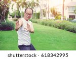 adult man doing kung fu for... | Shutterstock . vector #618342995