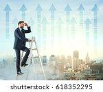 businessman on top of ladder... | Shutterstock . vector #618352295