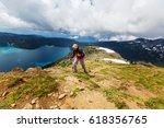 hiking man in canadian... | Shutterstock . vector #618356765