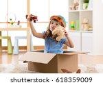 kid child pilot flying a... | Shutterstock . vector #618359009