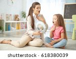 young woman teacher and little... | Shutterstock . vector #618380039