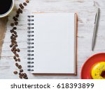 opened notepad and cup of... | Shutterstock . vector #618393899