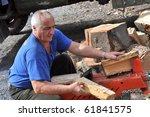 Man Using A Log Splitter