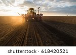 farmer with tractor seeding  ... | Shutterstock . vector #618420521