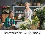 two florists working in flower... | Shutterstock . vector #618420557