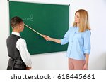female teacher and schoolboy at ... | Shutterstock . vector #618445661