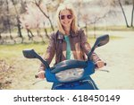 young woman driving scooter or... | Shutterstock . vector #618450149
