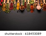 various spices on black slate