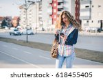 cute girl with a cup of coffee... | Shutterstock . vector #618455405
