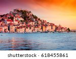 Sunset in old town of Sibenik, Croatia. Waterfront view with reflection - stock photo