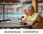 elderly couple with a laptop | Shutterstock . vector #618456911
