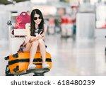 young asian girl using... | Shutterstock . vector #618480239